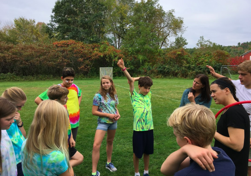 The Happy Campers connecting Lyme School Values to their group initiative